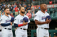 Jacksonville Jumbo Shrimp Cody Poteet (21), J.C. Millan (20), and Stone Garrett (31) during the national anthem before a Southern League game against the Mobile BayBears on May 28, 2019 at Baseball Grounds of Jacksonville in Jacksonville, Florida.  Mobile defeated Jacksonville 2-1.  (Mike Janes/Four Seam Images)