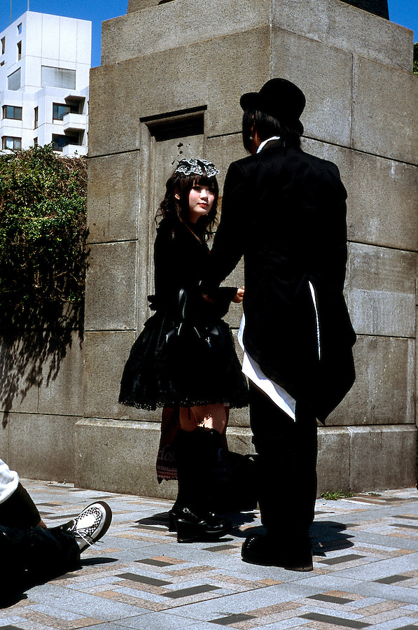 A young couple on the streets of Harajuku show off their latest styles - manga comics have had a strong influence on the fashions of the younger generation of Japanese.