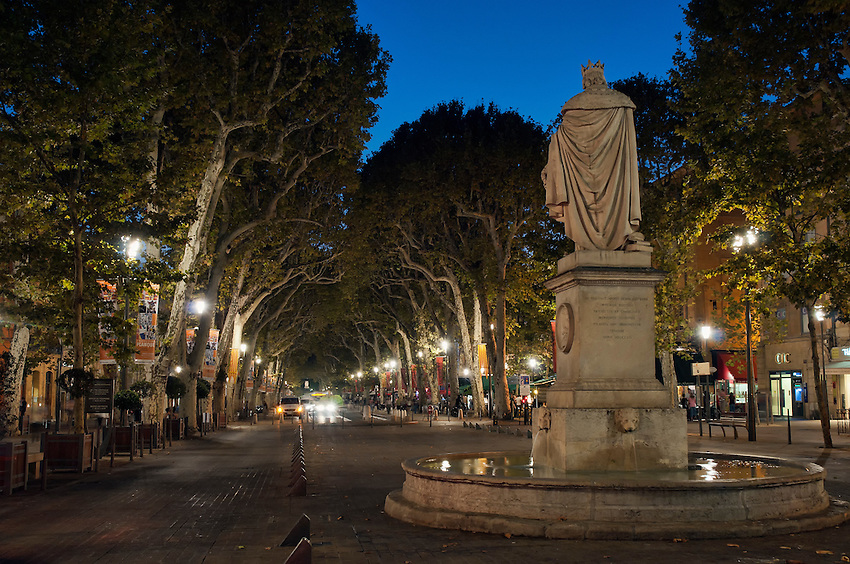 "A view down the Cours Mirabeau in Aix-en-Provence, Provence, France, during the ""blue hour"" after sunset"
