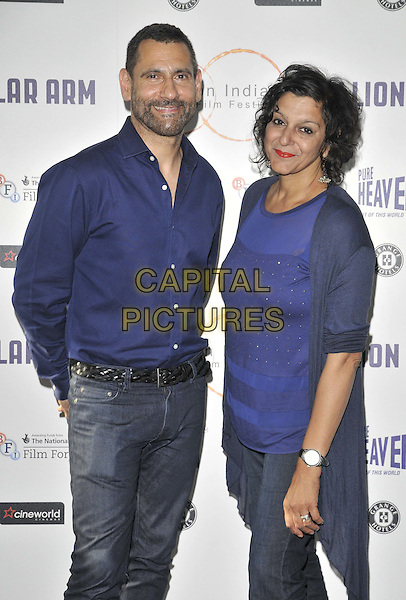 LONDON, ENGLAND - JULY 14: guest &amp; Meera Syal attend the London Indian Film Festival &quot;Million Dollar Arm&quot; UK film premiere, Cineworld Shaftesbury Avenue cinema, Coventry St., on Monday July 14, 2014 in London, England, UK. <br /> CAP/CAN<br /> &copy;Can Nguyen/Capital Pictures