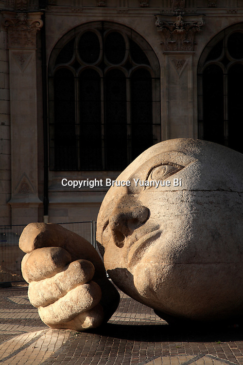 Stone statue of the Listener(l'ecoute)by Henir de Miller outside of Saint-Eustache Church. Les Halles. City of Paris. Paris
