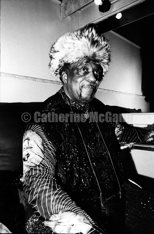 NEW YORK - 1987:  Jazz composer and band leader Sun Ra poses for a portrait backstage at the Bottom Line in 1987  in New York City, New York. (Photo by Catherine McGann).Copyright 2010 Catherine McGann