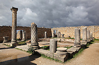 Central courtyard of the House of the Columns, with different style columns around its central pool, including a spiral column with a Corinthian capital, Volubilis, Northern Morocco. Volubilis was founded in the 3rd century BC by the Phoenicians and was a Roman settlement from the 1st century AD. Volubilis was a thriving Roman olive growing town until 280 AD and was settled until the 11th century. The buildings were largely destroyed by an earthquake in the 18th century and have since been excavated and partly restored. Volubilis was listed as a UNESCO World Heritage Site in 1997. Picture by Manuel Cohen