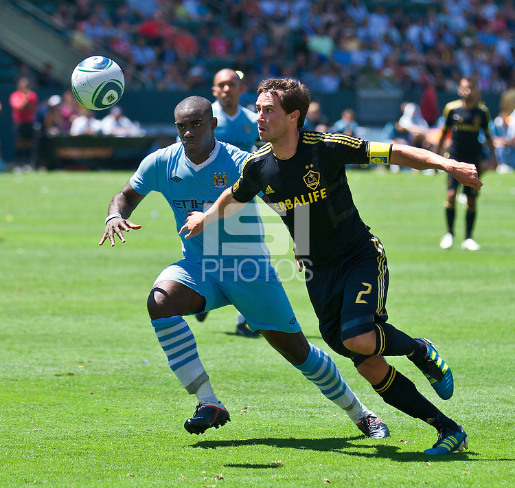 CARSON, CA – July 24, 2011: Micah Richards (2) of Manchester City and Todd Dunivant (2) of LA Galaxy during the match between LA Galaxy and Manchester City FC at the Home Depot Center in Carson, California. Final score Manchester City FC 1 and LA Galaxy 1. Manchester City wins shoot out 7, LA Galaxy 6.