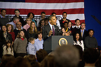US President Barack Obama delivers a speech at the Central High School gymnasium in Manchester, New Hampshire, on Tuesday, Nov. 22, 2011.  During the speech, Obama directly challenged Congress on the economy and spoke about the American Jobs Act, a law he stresses as necessary to ease taxes for ordinary Americans and promote job growth.  The speech was interrupted briefly by Occupy protesters who were quickly drowned out by supporters.
