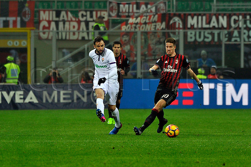 February 19th 2017, San Siro, Milan, Italy; Mario Pasalic of Milan in action against Giacomo Bonaventura during  Serie A football, AC Milan versus Fiorentina;