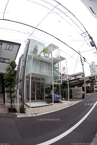 """June 11, 2012, Tokyo, Japan - The transparent house """"House NA"""" designed by Sou Fujimoto is located in a residential area of Tokyo, Japan. The concept of the design is associated with the concept of living in the trees. This 914 square-foot transparent house contrasts with the other houses made of concrete or wood around it."""