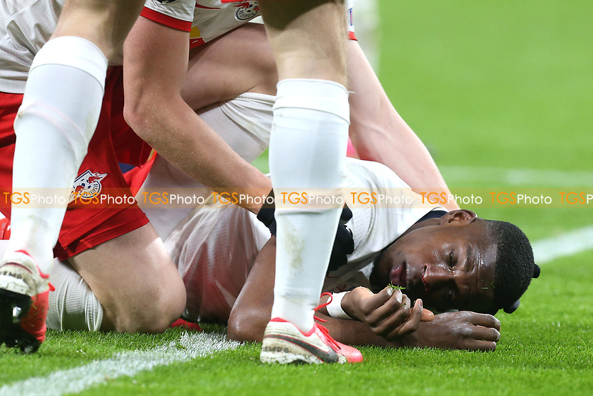 Nordi Mukiele of RB Leipzig /lies unconcious during RB Leipzig vs Tottenham Hotspur, UEFA Champions League Football at the Red Bull Arena on 10th March 2020