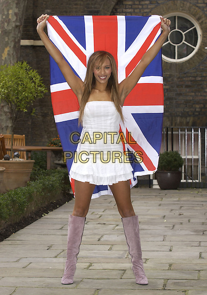 JAVINE.Who will be singer for English Eurovision Song Contest entry..Ref: PL.March 6th, 2005.full length flag union jack pink velvet boots white dress gesture.www.capitalpictures.com.sales@capitalpictures.com.©Capital Pictures.