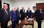Mahmoud Khalifa sworn in as ambassador of the State of Palestine to Poland in front of Palestinian President Mahmoud Abbas, at his headquarters in the West bank city of Ramallah on March 4, 2018. Photo by Thaer Ganaim