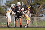 Palos Verdes, CA 03/30/10 - Andrew Castillo (Peninsula #14), Charles Castillo (Peninsula #23) and \pvj37\ in action during the Palos Verdes-Peninsula JV Boys Lacrosse game.