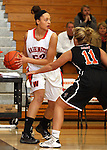 SIOUX FALLS, SD: DECEMBER 10: Sydney Koel #52 from Washington looks for a teammate while being pressured by Allysen Fuller #11 from Sioux City East in the first quarter of their season opener Tuesday night at Washington. (photo by Dave Eggen/Inertia)
