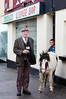 4/10/2010.  Horse dealer Tommy Cullanan from Ennis and 9 year old Dany O Shea from Cork are pictured with Sam the pony outside the Emerald bar at the Ballinasloe Horse Fair, Ballinasloe, County Galway, Ireland. Picture James Horan