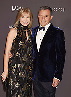 LOS ANGELES, CA - NOVEMBER 04: Chairman and Chief Executive Officer of The Walt Disney Company Bob Iger (R) and LACMA Trustee Willow Bay attend the 2017 LACMA Art + Film Gala Honoring Mark Bradford and George Lucas presented by Gucci at LACMA on November 4, 2017 in Los Angeles, California.<br /> CAP/ROT/TM<br /> &copy;TM/ROT/Capital Pictures