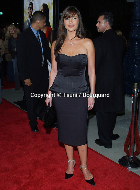 """Catherine Zeta-Jones arriving at the """" Intolerable Cruelty """" Premiere at the Academy of Motion Picture Arts and Sciences in Los Angeles. September 30, 2003."""