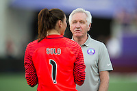 Orlando, Florida - Sunday, May 8, 2016: Orlando Pride head coach Tom Sermanni speaks with Seattle Reign FC goalkeeper Hope Solo (1) after a National Women's Soccer League match between Orlando Pride and Seattle Reign FC at Camping World Stadium.