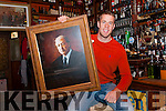Dingle Dick Mack's owner's nephew Finn McDonnell with the painting which was stolen from the pub and promptly brought back.