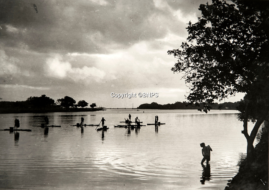 BNPS.co.uk (01202 558833)<br /> Pic: PhilYeomans/BNPS<br /> <br /> Album also contains pictures of local scene's - here native fishermen in Madras.<br /> <br /> Last Days of the Raj - A fascinating family album from one of the last Viceroy's of India reveal Britain's 'Jewel in the Crown' in all its splendour.<br /> <br /> The family album of Viscount George Goschen has been unearthed after 90 years, and provide's an amazing snapshot of the pomp and pageantry of a wealthy and powerful British family in India in the 1920s and 30's.<br /> <br /> They show the Governor of Madras and his family enjoying a lavish lifestyle of parades, banquets and hunting and horse racing in the last decades of the Raj.<br /> <br /> At the time, Gandhi was organising peasants, farmers and labourers to protest against excessive land-tax and discrimination. <br /> <br /> The album consists of some 300 large photographs. They have remained in the family for 90 years but have now emerged for auction following a house clearance and are tipped to sell for &pound;200.
