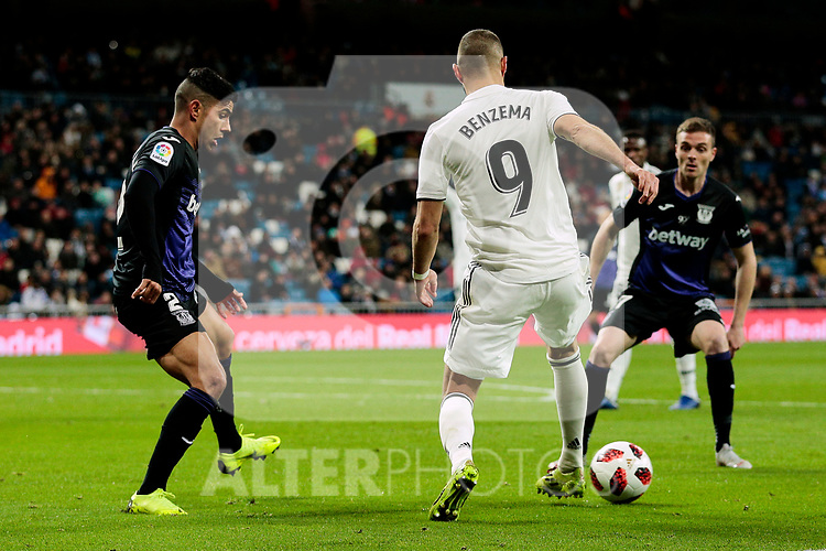Real Madrid's Karim Benzema and CD Leganes's Juan Francisco Moreno during Copa Del Rey match between Real Madrid and CD Leganes at Santiago Bernabeu Stadium in Madrid, Spain. January 09, 2019. (ALTERPHOTOS/A. Perez Meca)