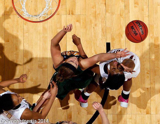 SIOUX FALLS, SD - MARCH 8:  Holly Johnson #12 from NDSU battles for the ball with Dawn Luster #32 from IUPUI  in the second half of their game Saturday afternoon at the 2014 Summit League Tournament in Sioux Falls, SD.(Photo by Dave Eggen/Inertia)