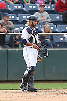 Arturo Nieto (25) of the Everett AquaSox in the field at catcher during a game against the Spokane Indians at Everett Memorial Stadium on July 24, 2015 in Everett, Washington. Everett defeated Spokane, 8-6. (Larry Goren/Four Seam Images)
