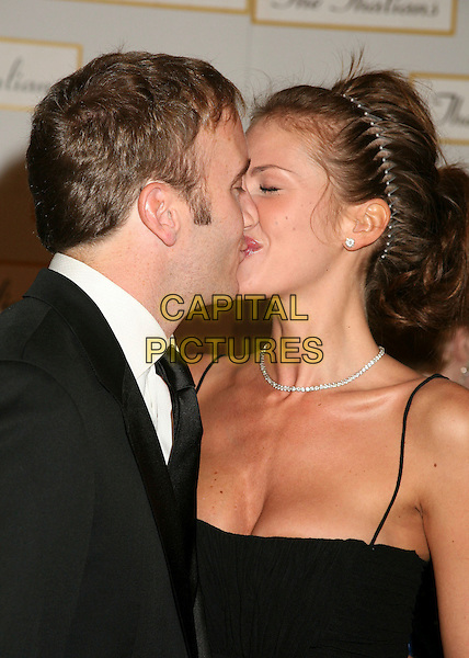 JAY MOHR & NIKKI COX.The 51st Annual Thalians Ball at the Hyatt Regency Century Plaza Hotel, Century City, California, USA..October 7th, 2006.Ref: ADM/BP.headshot portrait alice band cleavage diamond necklace kiss kissing couple.www.capitalpictures.com.sales@capitalpictures.com.©Byron Purvis/AdMedia/Capital Pictures.