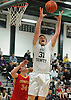 Aidan Barry #31 of Holy Trinity grabs a rebound during a CHSAA varsity boys' basketball game against Chaminade at Holy Trinity High School on Tuesday, Feb. 2, 2016. Holy Trinity outscored Chaminade 14-2 in the third quarter and won by a score of 63-53.