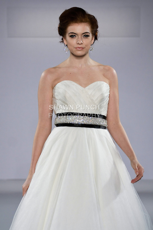 Model walks runway in a Chloe wedding dress from the Matty by Matthew Christopher Spring 2013 collection, at the Couture Show, during New York Bridal Fashion Week Spring 2013.
