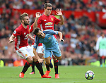 David Silva of Manchester City tackled by Luke Shaw and Ander Herrera of Manchester United during the Premier League match at Old Trafford Stadium, Manchester. Picture date: September 10th, 2016. Pic Simon Bellis/Sportimage
