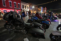 ROT Biker Rally fans and thousands of thundering motorcycles roam the 6th street bar district while spectators enjoy the scene on a warm summer night in downtown, Austin, Texas.