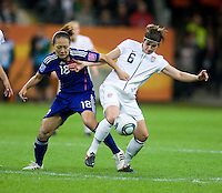Amy Lepeilbet (6) of the United States fights for the ball with Karina Maruyama (18) of Japan during the final of the FIFA Women's World Cup at FIFA Women's World Cup Stadium in Frankfurt Germany.  Japan won the FIFA Women's World Cup on penalty kicks after tying the United States, 2-2, in extra time.