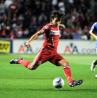 Chicago Fire midfielder Baggio Husidic (9) sends in a cross during the first half of a match between the San Jose Earthquakes and the Chicago Fire at Toyota Park in Bridgeview, IL on April 10, 2010.  San Jose Earthquakes 2, Chicago Fire 1.