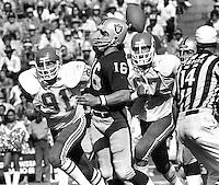 Oakland Raiders QB Jim Plunkett passing against the kansas City Chiefs, Ken Kremer, and Art Still rushing.<br />(1980 photo/ Ron Riesterer)