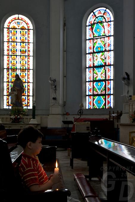 Child Praying for Corazon Aquino, near Adamson University Church next door