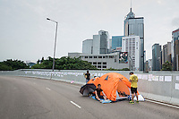 Hong Kong, Government Offices, 2 October 2014<br /> <br /> Students and other supporters of the Occupy Central movement congregating around the government offices area at Tamar. All the roads in the area are blocked from traffic and public transport.<br /> Many students and activists spent a fourth night sleeping on the street, sometimes in a fancy tent.<br /> <br /> Photo Kees Metselaar