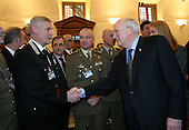 United States Vice President Dick Cheney thanks Italian military members who served in Afghanistan and Iraq after addressing Italian politicians and young professionals at the Palazzo Minerva in Rome, Italy on January  26, 2004.  About 3,000 Italian troops and law enforcement officers were sent to Iraq to help rebuild the nation after the fall of Baghdad on April 9, 2003.  <br /> Mandatory Credit: David Bohrer / White House via CNP