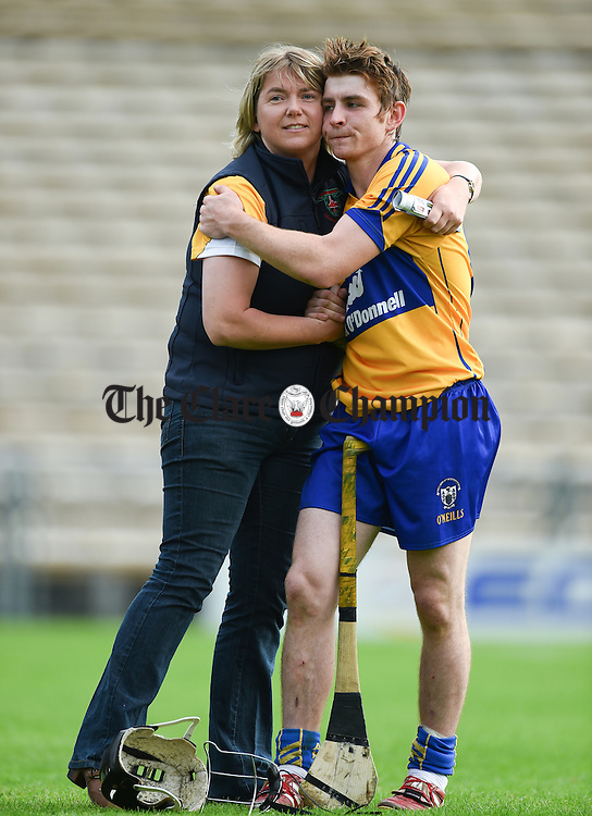 Orla Considine consoles Michael O Neill of Clare following their Intermediate All-Ireland final against Kilkenny at Thurles. Photograph by John Kelly.