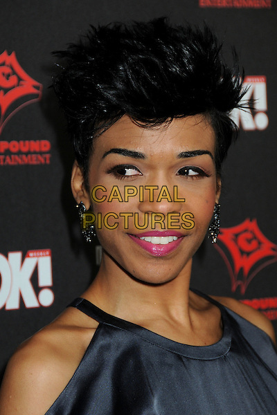 MICHELLE WILLIAMS .3rd Annual Midnight Grammy Brunch held at the W Hollywood Hotel,  Hollywood, California, USA, .30th January 2010..portrait headshot hair quiff pink lipstick make-up dangly earrings black silk satin cut out shoulders .CAP/ADM/BP.©Byron Purvis/Admedia/Capital Pictures