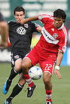 13 June 2009: Chicago's Wilman Conde (22) and DC's Chris Pontius (left). DC United defeated the Chicago Fire 2-1 at RFK Stadium in Washington, DC in a regular season Major League Soccer game.