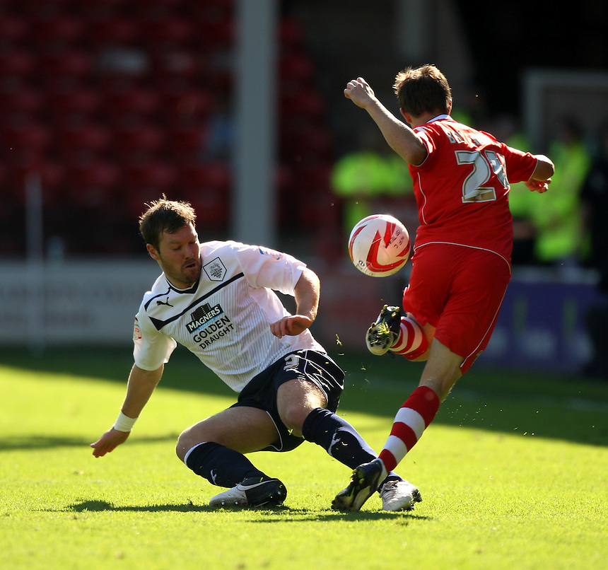 Preston North End's Scott Laird battles with Walsall's James Baxendale ..Football - npower Football League Division One - Walsall v Preston North End - Saturday 22nd September 2012 - Banks's Stadium - Walsall..