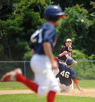 Falls second baseman Patrick Lawrence (right) attempts to throw out Yardley Western's Anthony Raposelli #21 after forcing out Yardley Western's Ben Raab #46 in the 3rd inning at Neshaminy High School Sunday July 5, 2015 in Langhorne, Pennsylvania. (Photo by William Thomas Cain)