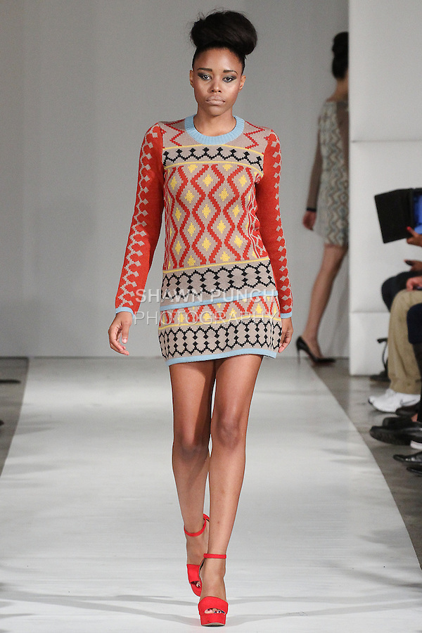 Model walks runway in an outfit from the Maxhosa by Laduma Spring Summer 2015 Amakrwala collection during Fashion Week Brooklyn Spring Summer 2015.