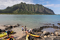 Kayakers at Chinaman's Hat Island, with Kualoa Regional Park in the distance, Windward O'ahu.