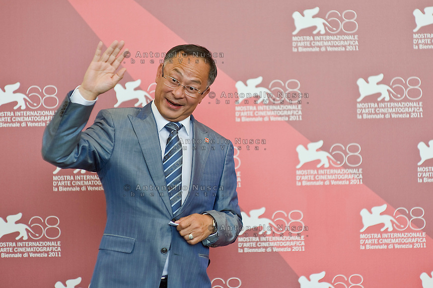 Hong Kong film director Johnnie To poses during the photocall of 'Duo Mingjin (Life without principle)' at the 68th Venice Film Festival