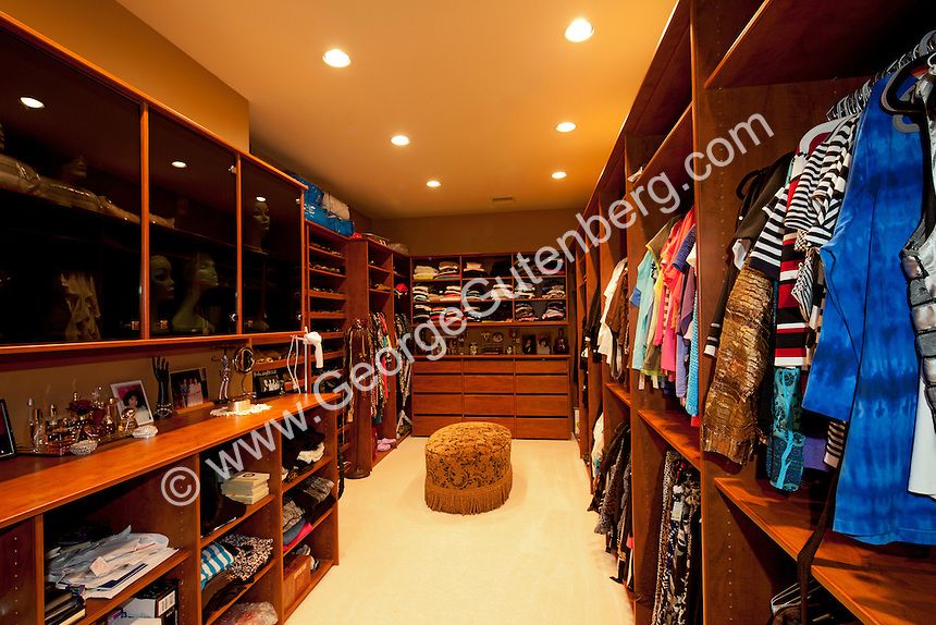 Large walk-in closet with nice built-ins