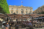 People at cafe tables in front of National Library building, Republic Square, Valletta, Malta