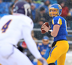 BROOKINGS, SD - NOVEMBER 15: Austin Sumner #6 from South Dakota State University looks for a receiver as Jonathon Rollins #4 from Western Illinois defends in the first quarter Saturday afternoon at Coughlin Alumni Stadium in Brookings. (Photo by Dave Eggen/Inertia)