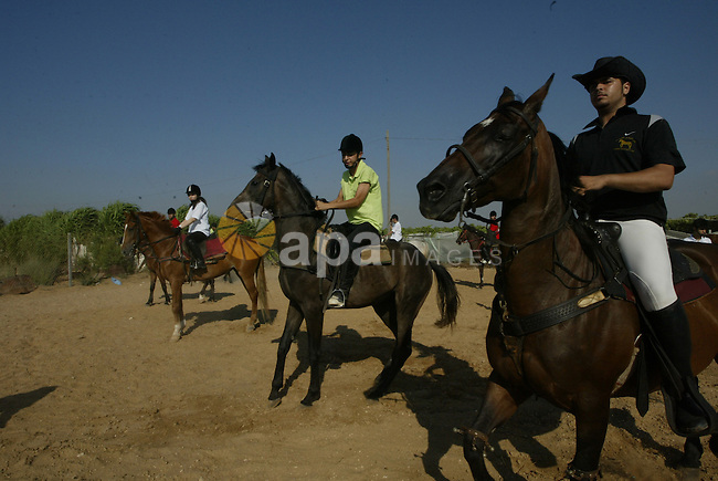 "Palestinians ride horses during the ""Jump Championship"" local race in Gaza  City July 15, 2010. Photo by Ashraf Amra"
