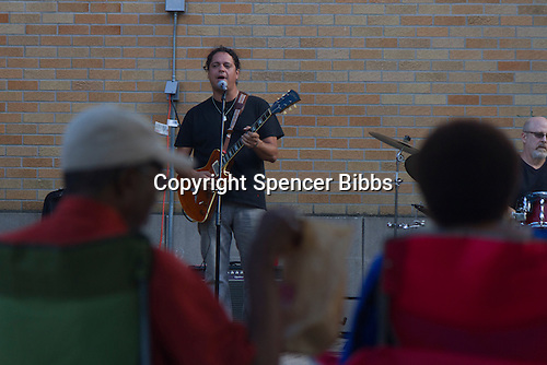 Dave Herrero played the George Franklin Summer Concert Series Sunday evening in Nichols Park located at 1355 E. 53rd Street.<br /> <br /> Please 'Like' &quot;Spencer Bibbs Photography&quot; on Facebook.<br /> <br /> All rights to this photo are owned by Spencer Bibbs of Spencer Bibbs Photography and may only be used in any way shape or form, whole or in part with written permission by the owner of the photo, Spencer Bibbs.<br /> <br /> For all of your photography needs, please contact Spencer Bibbs at 773-895-4744. I can also be reached in the following ways:<br /> <br /> Website &ndash; www.spbdigitalconcepts.photoshelter.com<br /> <br /> Text - Text &ldquo;Spencer Bibbs&rdquo; to 72727<br /> <br /> Email &ndash; spencerbibbsphotography@yahoo.com