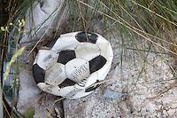 Discarded deflated soccer ball. Zawady Central Poland